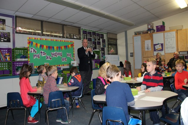 Under Secretary of the Army Joseph W. Westphal addresses students at Brookwood Elementary School in Leawood, Kan., Nov. 11, 2013. Westphal toured the school and met with students to reinforce the importance of Veterans Day and the contributions of veterans to American history.