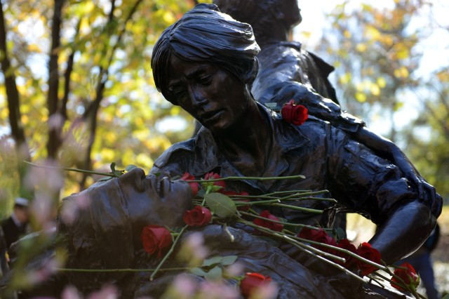 The Vietnam Women's Memorial in Washington, D.C., shows a nurse cradling an injured Soldier.
