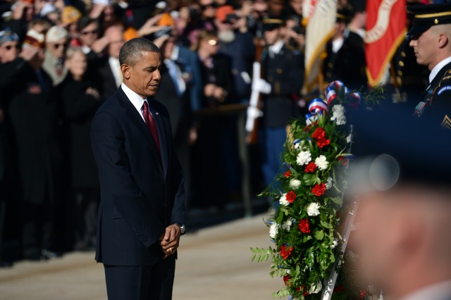 President Barack Obama pauses before a wreath he placed at the Tomb of the Unknowns during a Veterans Day ceremony at Arlington National Cemetery, Va., Nov. 11, 2013.