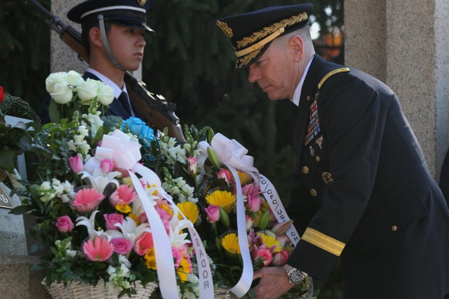 Eighth Army Commanding General Lt. Gen. Bernard S. Champoux places a wreath at the Eighth Army Memorial on Yongsan Garrison, South Korea, Nov. 11, 2013.