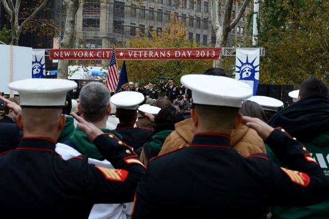 Veterans and service members salute as the National Anthem plays during a Veterans Day wreath-laying ceremony in New York City.