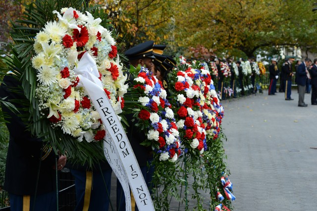 Service members stand watch over the wreathes honoring veterans during a ceremony in New York City on Veterans Day.