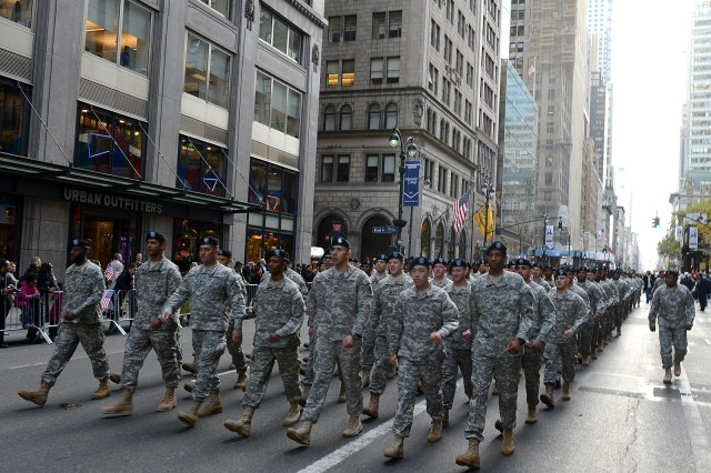 Soldiers from the 77th Sustainment Brigade sing cadence as they march in the 2013 Veterans Day Parade in New York City.