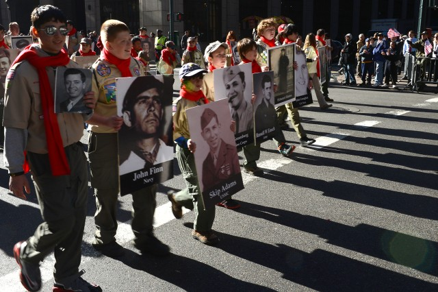 Boy Scouts carry portraits of veterans from New York during the 2013 Veterans Parade in New York City. More than 20,000 people and 200 organizations participated in the parade.