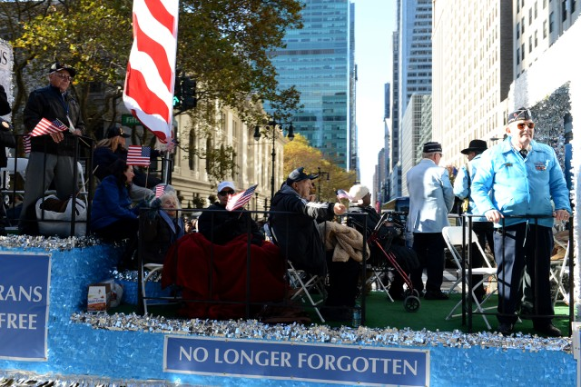 Korean War veterans ride in the 2013 Veterans Day Parade in New York City. Veterans from World War II to today marched in the parade.