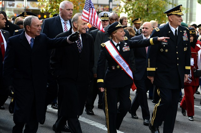Retired Gen. Ann Dunwoody calls out to New Yorkers as she leads the 2013 Veterans Day Parade in New York City on 5th Avenue. She was selected as the grand marshal as part of the city's salute to women who have served and continue to serve in the armed forces.