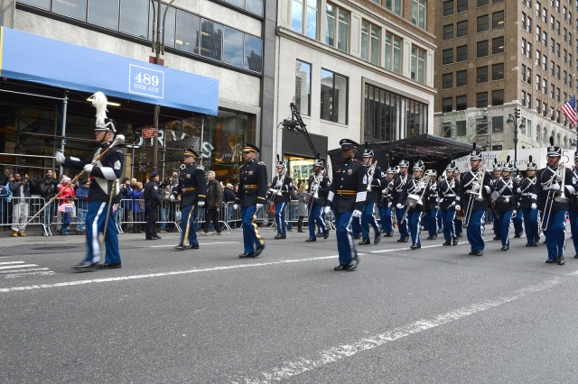 The U.S. Military Academy Band provides patriotic music as they march up 5th Avenue, during the 2013 Veterans Day Parade in New York City. Thousands of New Yorkers lined the street to watch the parade.