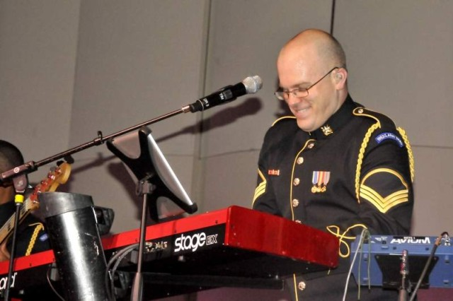 "The U.S. Army Band's Staff Sgt. Tim Whalen plays the keyboard during the classic rock of The Who concert Nov. 2 at Joint Base Myer-Henderson Hall's Brucker Hall. Whalen also arranged the orchestration and vocals for the combined ""Pershing's Own"" groups of Downrange and The U.S. Army Band Rock Orchestra."