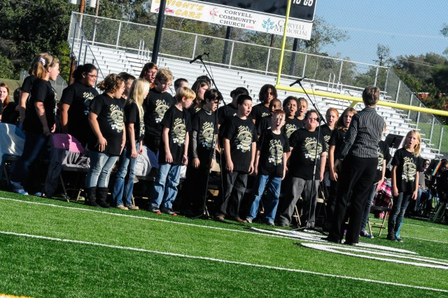 Gatesville Intermediate School students sing in honor of the local veterans during the Veteran's Day ceremony held at the school's football field in Gatesville, Texas, Nov. 11. First Army Division West, whose partner community is Gatesville, provided the guest speaker for the event, plus a static display of military vehicle. (Photo by Staff Sgt. Tony Foster, Division West Public Affairs)