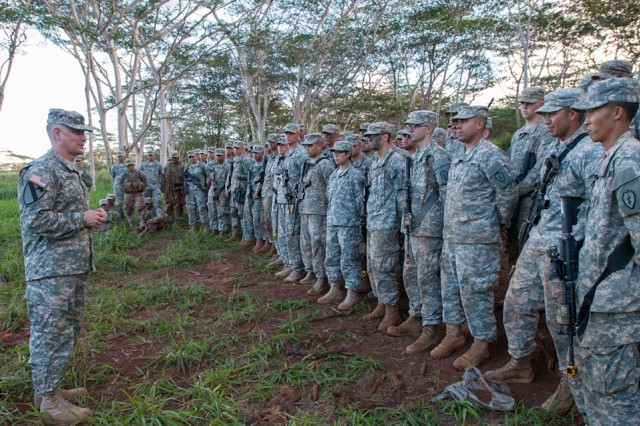 Sgt. Maj. of the Army Raymond F. Chandler III talks with Soldiers assigned to the 3rd Squadron, 4th Cavalry Regiment, 3rd Brigade Combat Team, 25th Infantry Division, after observing a live fire demonstration in the jungle terrain of Schofield Barracks, Hawaii.