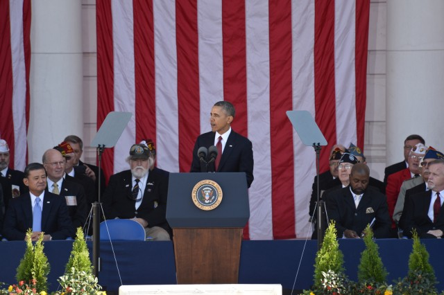 President Barack Obama speaks to audience members during the National Veterans Day Observance hosted by the Department of Veterans Affairs held at the Memorial Amphitheater, Arlington National Cemetery, Nov. 11, 2013.