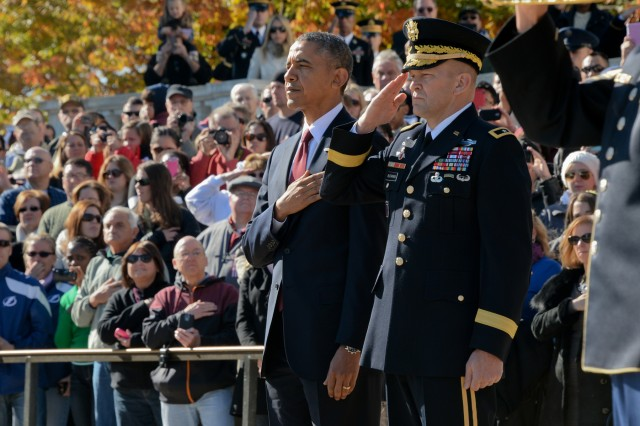 President Barack Obama and Maj. Gen. Jeffrey S. Buchanan, U.S. Army Military District of Washington commanding general, pay their respects during the National Veterans Day Observance Armed Forces Full Honor Presidential Wreath-Laying Ceremony at the Tomb of the Unknowns, Arlington National Cemetery, Nov. 11, 2013.