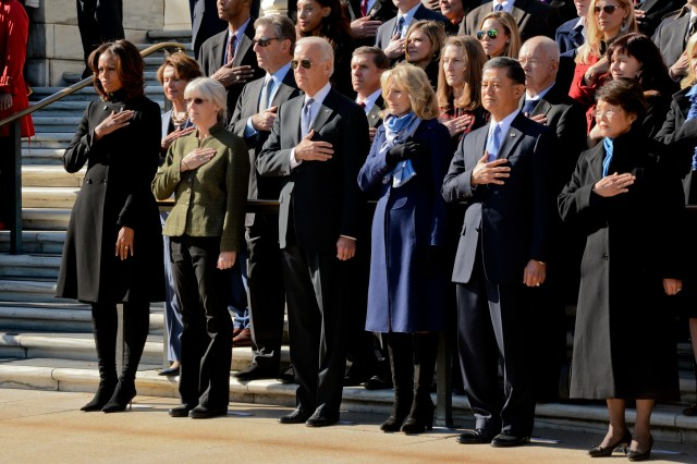 Michelle Obama renders honors along with other members of the official party during the National Veterans Day Observance Ceremony at the Tomb of the Unknowns, Arlington National Cemetery, Nov. 11, 2013.