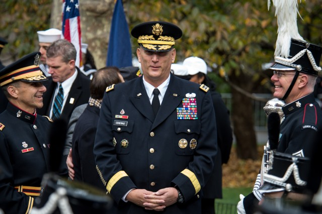 "U.S. Army Chief of Staff, Gen. Ray Odierno (middle) speaks with Commander/Conductor Lt. Col. Jim Keene (left) and Sgt. Maj. Douglas Richard of The West Point band before the opening ceremony of the Veterans Day Parade ""America's Parade"" on November 11, 2013 in Manhattan, New York.  (U.S. Army Photo by Sgt. Mikki L. Sprenkle)"