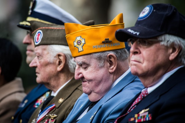 "Veterans listen to the opening remarks of the Veterans Parade ""America's Parade"" on November 11, 2013 in Manhattan, New York.  (U.S. Army Photo by Sgt. Mikki L. Sprenkle)"