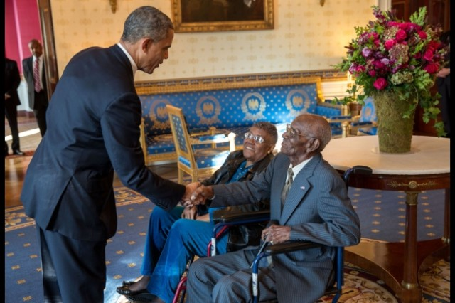 President Barack Obama greets Richard Overton, with Earlene Love-Karo, at the White House, Nov. 11, 2013. Overton and his guest attended the Veteran's Day Breakfast at the White House.