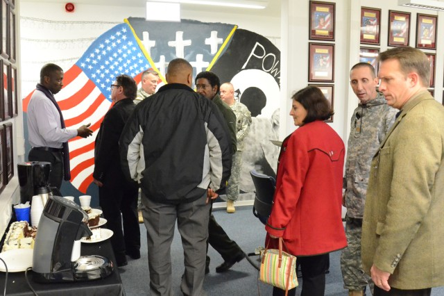 Visitors view the photos of fallen Soldiers during opening day of the Baumholder Remembrance Room Nov. 6. The room is dedicated to the memory of the 92 Baumholder Soldiers who lost their lives in combat, in an accident, or in training.  The room is also dedicated to the surviving family members.