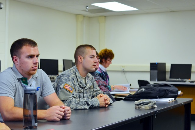 "Dennis Mayo, (center) a cadet working toward becoming a commissioned officer in the U.S Army Reserve, is a senior studying civil engineering at Marshall University. He listens to Derek Maxey, cost engineer with U.S. Army Corps of Engineers Huntington District, during a construction management course. Upon graduating from college and receiving his commission, Mayo will become an engineer officer. ""I am really interested in learning as much as possible from professionals in the field about forecasting, estimates, scheduling; assessing risks,"" said Mayo."