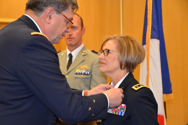 French Deputy Surgeon General Patrick Godart awards Lt. Gen. Patricia Horoho the French National Order of Legion of Honor.