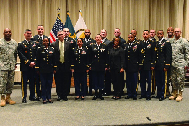 John E. Hall, Army Logistics University president, Col. Robert A. Harney Jr., ALU commandant, and Command Sgt. Maj. Clifton H. Johnson, Logistics NCO Academy commandant, post with the 2013 Distinguished instructor Award recipients after a ceremony to recognize and honor them.