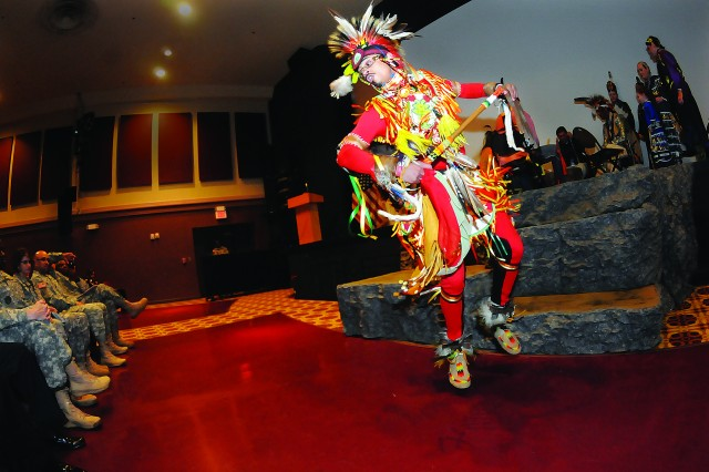Lenny Harmon of the Youghtanund Drummers and Singers performs the prairie chicken dance during the National Native American Heritage Month event Nov. 12 at the Fort Lee Theater. Harmon, a Lenape tribesman, said the dance has its roots in a mating ritual.
