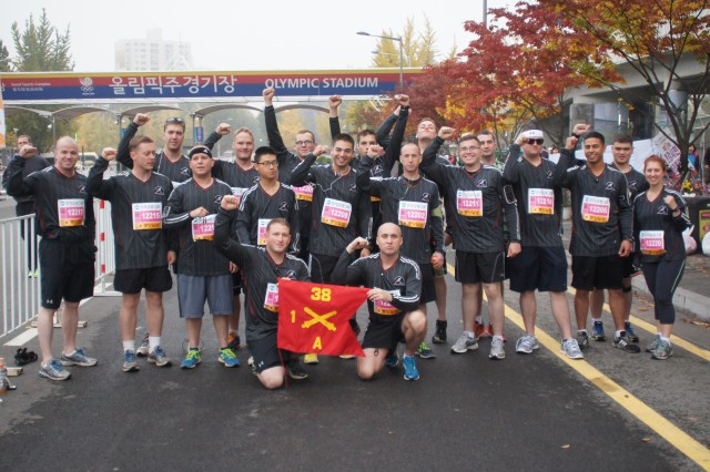 """SEOUL, South Korea """" Soldiers from A Battery, 1st Battalion, 38th Field Artillery Regiment, 210th Fires Brigade, 2nd Infantry Division, celebrate completing the Joongang Seoul Marathon as a team Nov. 3."""