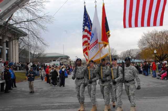 Third Brigade Combat Team, 10th Mountain Division soldiers carrying the national, Army and 10th Mountain Division colors march in the Veterans Day parade held at the New York State Fairgrounds in Syracuse, N.Y., Nov 9.