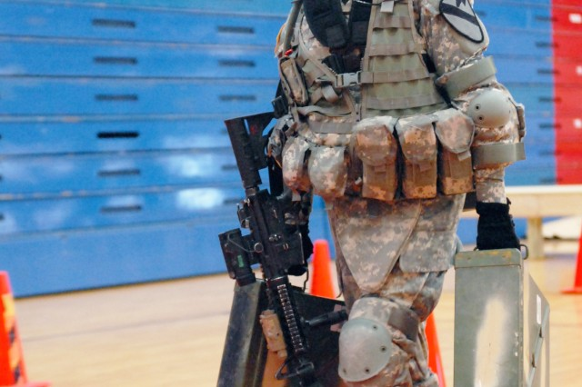 A Soldier assigned to the 1st Brigade Combat Team, 1st Cavalry Division, carries ammunition cans during a task in the Army's Physical Demand Study at Fort Hood, Texas, Sept. 13, 2013. The task was one of five engineer-specific tasks performed by Soldiers.
