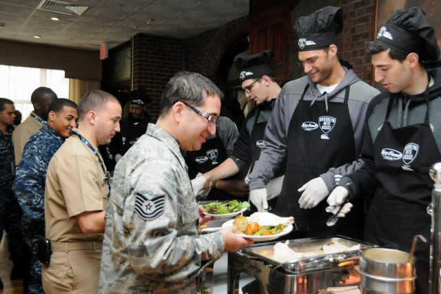 In the spirit of Thanksgiving, Brooklyn Nets serve service members dinner at the Fort Hamilton community club during their visit Nov. 11 to pay tribute to all veterans on Veterans Day.