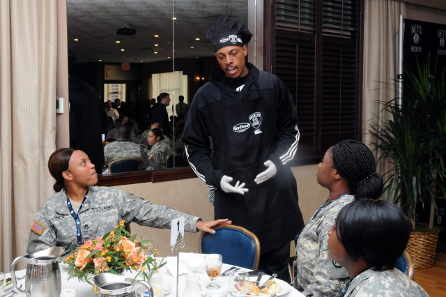 Brooklyn Nets small foward Paul Pierce serves as a waiter to service members at the Fort Hamilton community club Nov. 11 as part of the team's tribute to the military on Veterans Day.