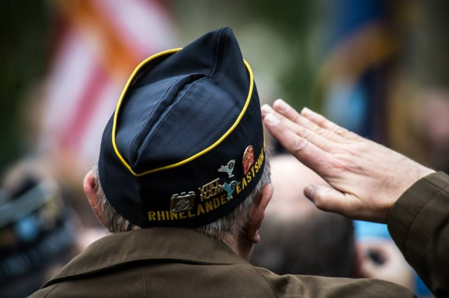 "A Veteran salutes during the retiring of the colors at the Veterans Day Parade, ""America's Parade"" on November 11, 2013 in Manhattan, New York. (U.S. Army Photo by Sgt. Mikki L. Sprenkle) Digital"