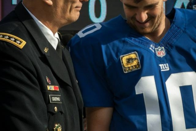 U.S. Army Chief of Staff, Gen. Ray Odierno, shakes hands with Eli Manning, before the New York Giants vs. Oakland Raiders game at the MetLife Stadium, East Rutherford, NJ on November 10, 2013 (U.S. Army Photo by Sgt. Mikki L. Sprenkle/Released) Digital