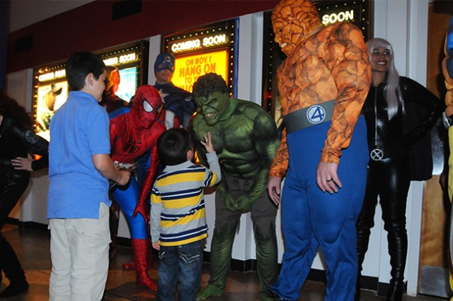 Soldiers dressed as Marvel superheroes entertain children during the grand reopening of the Fort Rucker Theater Nov. 8.