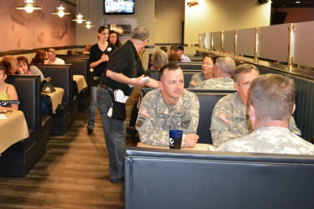 "Soldiers and civilians stop and eat lunch at The Landing Zone during its grand opening. As a token of appreciation to military Families, two children 12 and younger eat for free Tuesdays""Saturdays at The Landing Zone. Children must order off the children's menu and adults must purchase an adult dinner entrée and beverage. For more information, call 598-8025."