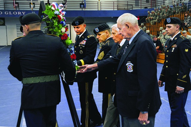 Military and civilian leaders lay a wreath at the center of Magrath Sports Complex on Thursday as a way of honoring the sacrifices of U.S veterans during Fort Drum's observance of Veterans Day. From left, are Maj. Gen. Stephen J. Townsend, Fort Drum and 10th Mountain Division (LI) commander; Command Sgt. Maj. Rick Merritt, 10th Mountain Division (LI) senior enlisted adviser; William Morrison, president of the Upstate New York Chapter of the National Association of the 10th Mountain Division; and retired Col. Mike Plummer, president of the Fort Drum Chapter of the National Association of the 10th Mountain Division.