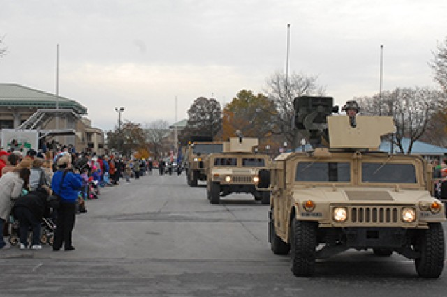 Vehicles of the 3rd Brigade Combat Team pass by spectators during the Veterans Day parade held Saturday at the New York State Fairgrounds in Syracuse.