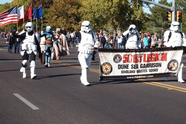 "The 501st Legion Dune Sea Garrison, Arizona Chapter marches down Fry Boulevard in ""Star Wars"" costumes during the Veterans Day Parade Monday in Sierra Vista. The Lucasfilm-approved costume club received head-turning attention from parade spectators and was perhaps the most unique organization to participate in the event."