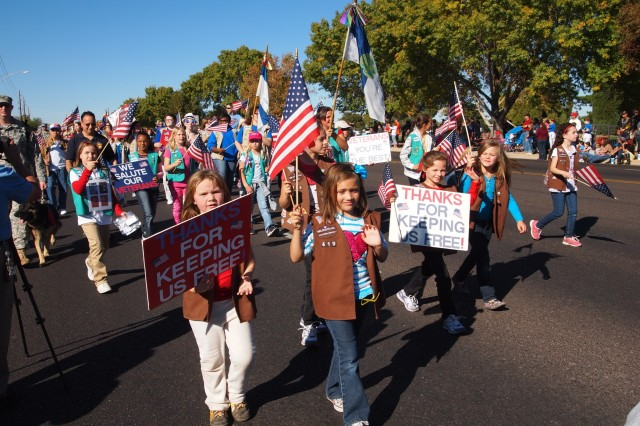 Cochise County Girl Scout Troops walk with signs thanking veterans during the 19th annual Veterans Day Parade Monday in Sierra Vista. Closely following the Girl Scouts in the parade order were the Cochise District Boy Scouts of America.