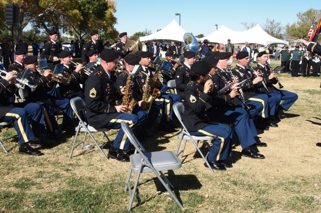 The Military Intelligence Corps Band plays military songs of all branches of service during a Veterans Day Ceremony held inside Veteran's Memorial Park Monday. Active duty, retired and veteran personnel were asked to stand and sing as their branch of service's song was played.
