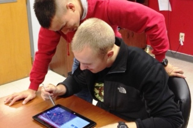 Iowa State University Cadet Jason Sadowski (seated) and Cadet Tan Thai review an ROTC lesson on a tablet. Cadets around the country benefit from the introduction of electronic textbooks.