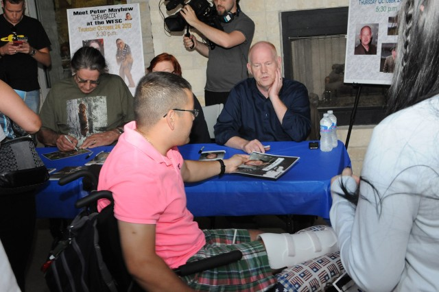 FORT SAM HOUSTON, Texas - Sgt. David Baldenegro (center left) chats with Glenn Morshower after getting his autograph Oct. 24 at the Warrior and Family Support Center. Other celebrities meeting with Soldiers and family members were actors Peter Mayhew, Walter Jones and David Yost, in addition to an earlier visit by football legend Herschel Walker. Baldenegro, a native of Tucson, Ariz., is a horizontal engineer with Company B, Warrior Transition Battalion, Brooke Army Medical Center. Morshower is best known for his work on television as well as numerous other roles on the big screen.