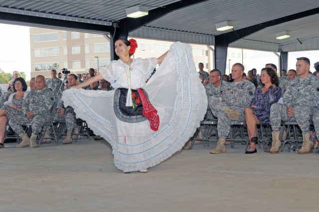 "FORT SAM HOUSTON, Texas - Belinda Menchaca of the Guadalupe Dance Company dances with a flourish Oct. 28 for the attendees of the Hispanic Heritage Month cultural reception U.S. Army South at the pavilion behind Building 1001. The event kicked off with Sgt. Maj. Linda Kessinger as the guest speaker. Her speech mirrored the theme of ""Serving and Leading our Nation with Pride and Honor."" Kessinger is the senior enlisted leader for personnel at U.S. Army North (Fifth Army). ""In my life, if I had listened to every person who said I would not be able to do something, I would not be standing in front of you today,"" she said. ""I have learned that the only limits to what you want to do in life are those limits you put upon yourself."""