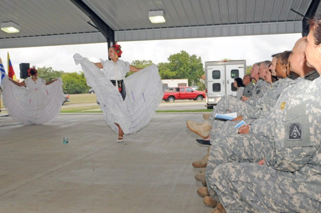 "FORT SAM HOUSTON, Texas - Jeannette Chavez (left) and Marlene Pita of the Guadalupe Dance Company twirl in a traditional dance Oct. 28 during the Hispanic Heritage Month cultural reception. The event was held at the pavilion behind Building 1001. The event kicked off with Sgt. Maj. Linda Kessinger, the guest speaker, whose speech mirrored the theme of ""Serving and Leading our Nation with Pride and Honor."" Kessinger is the senior enlisted leader for personnel at U.S. Army North (Fifth Army). ""By understanding the diverse nature of our Army and understanding the different heritages that are in our Army, we can then understand the Soldier next to us on our left and our right,"" she said."
