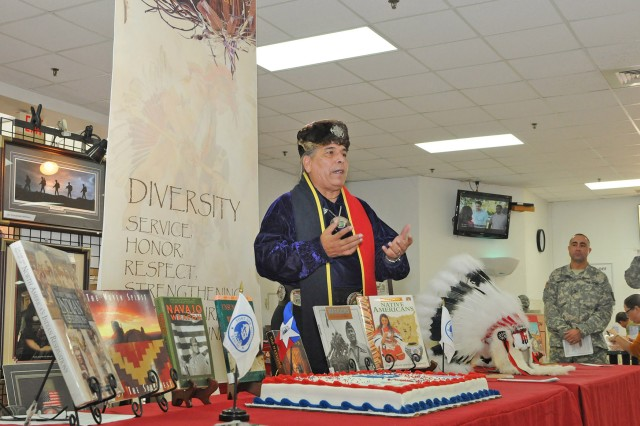 "FORT SAM HOUSTON, Texas - Erwin DeLuna speaks to those gathered Oct. 31 about the meaning and purpose of National American Indian Heritage Month at the Fort Sam Houston Post Exchange. This year's theme is ""Guiding Our Destiny with Heritage and Traditions."" The U.S. Army North (Fifth Army)-sponsored event was the official start to the historical month at Fort Sam Houston. ""I appreciate (being invited) out here to help participate and do these activities and events,"" said DeLuna, of the kickoff and other events planned throughout the month in the Fort Sam and San Antonio communities. DeLuna is the president of the United San Antonio Pow Wow Inc."