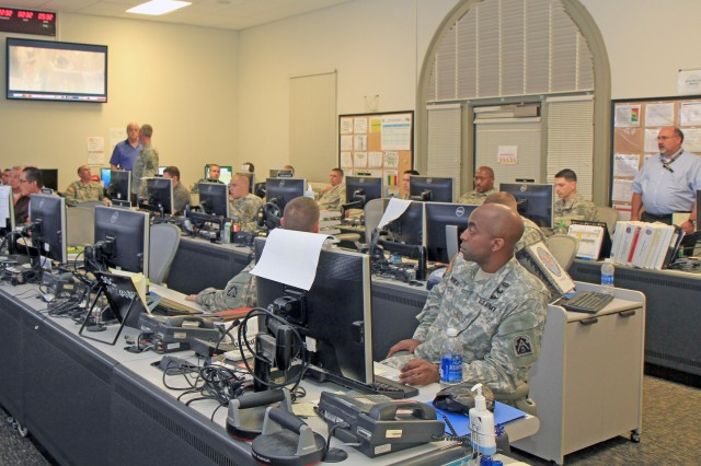 FORT SAM HOUSTON, Texas - The Soldiers and civilians of U.S. Army North (Fifth Army) review slides for the daily commander's update brief Oct. 30 as part of the shift change procedures in place during a local exercise.  The exercise ran from Oct. 28-Nov. 5. As an Army service component command and U.S. Northern Command's joint force land component command, Army North plays a key supporting role in the homeland.
