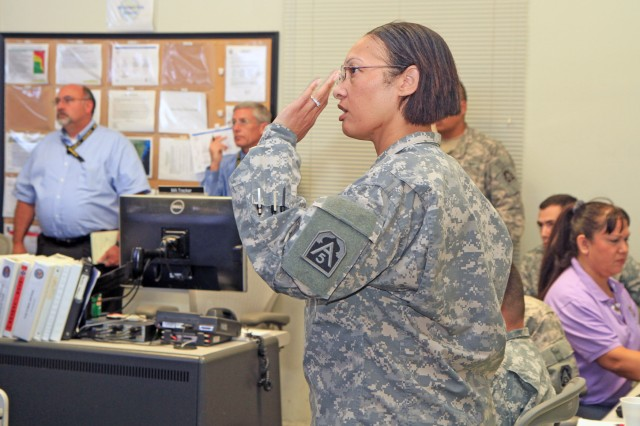 FORT SAM HOUSTON, Texas - Maj. Tracey Yeomans provides a shifts change update Oct. 30 during a local exercise. Yeomans serves as the chief of current operations with the Current Operations and Integration Center, U.S. Army North (Fifth Army).