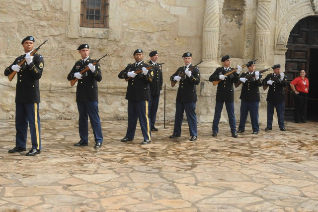 SAN ANTONIO - The Fort Sam Houston Army Honor Guard fires a volley in honor of veterans, past and present, Nov. 9 during a wreath-laying ceremony at the Alamo as part of San Antonio's annual Celebrate America's Military events.