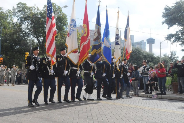 SAN ANTONIO - The Fort Sam Houston Joint Color Guard proudly bears the National and Service Colors Nov. 9 as part of the annual Celebrate America's Military Veteran's Parade in downtown San Antonio near the Alamo.