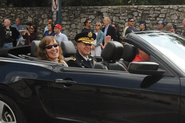 SAN ANTONIO - Maj. Gen. William Roy and his wife, Daneen, ride along as representatives of U.S. Army North (Fifth Army) Nov. 9 in the annual Celebrate America's Military Veteran's Parade in downtown San Antonio near the Alamo. Roy is the deputy commanding general of operations for Army North.