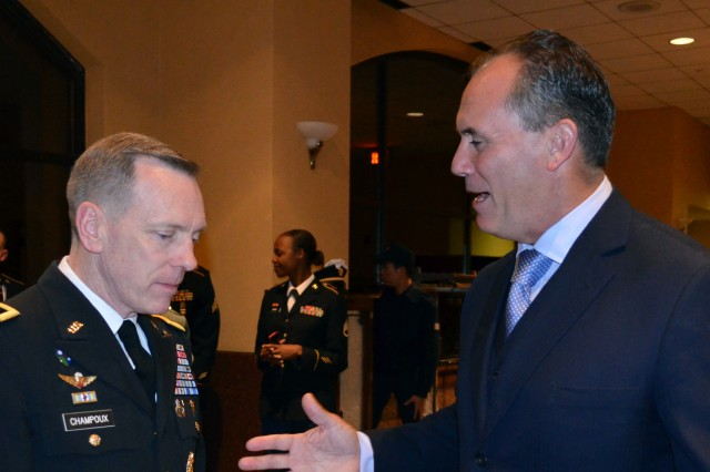 "OSAN AB "" Riki Ellison (left), chairman and founder of the non-profit Missile Defense Advocacy Alliance, speaks with Lt. Gen. Bernard Champoux, commanding general of Eighth Army, prior to the kickoff of the second annual Peninsula Missile Defender of the Year Ball held in Seoul, Nov. 8."